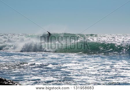 KALBARRI,WA,AUSTRALIA-APRIL 20,2016: Surfer in the large waves of the Indian Ocean at Jake's Point in Kalbarri, Western Australia.