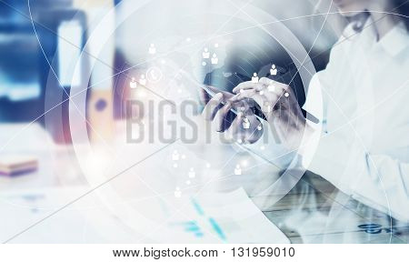 Picture business woman wearing white shirt, sending message smartphone.Open space loft office.Report documents, blurred background.Connections world wide interfaces.Horizontal, flares.Film effect