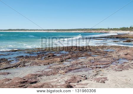 Indian Ocean seascape with rock formations at Jake's Point in Kalbarri, Western Australia on a clear day.