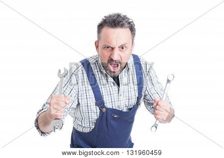 Mad Repairman Shouting And Defending With Mechanical Tools
