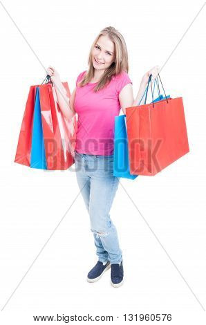 Shopaholic Young Girl Holding Shopping Bags In Both Hands
