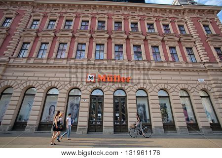 ZAGREB, CROATIA - MAY 26, 2016: Pedestrians walk past a M�¼ller Ltd. & Co. KG (Mueller) drug store.