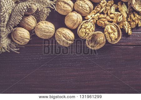 Walnuts On Dark Wood