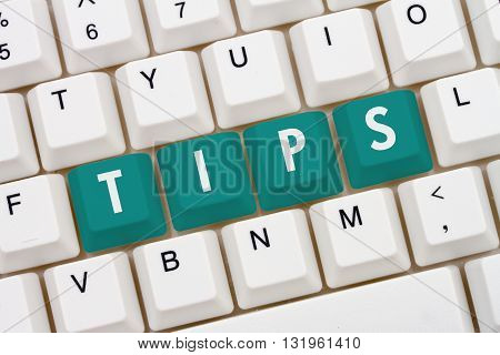 Getting Tips online A close-up of a keyboard with teal highlighted text Tips
