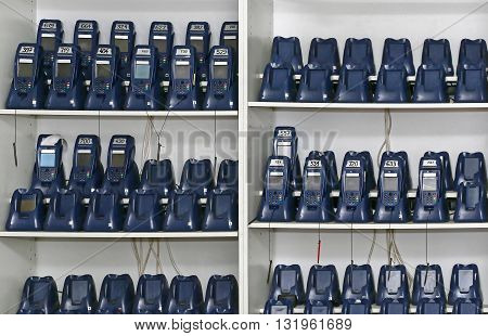 Charging Batteries of Barcode Scanners in Wall Shelf
