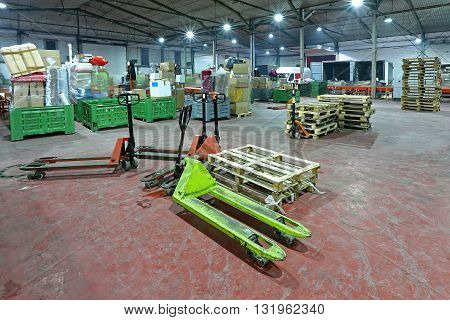Manual Pallet Jack Truck in Distribution Warehouse