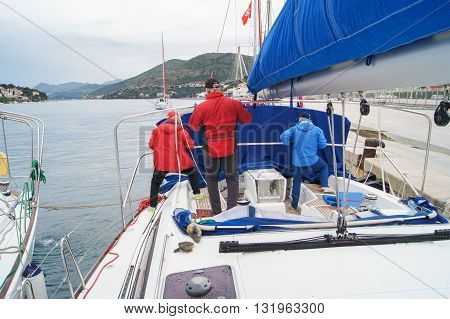 Tivat, Montenegro - 24 April, People on the boat near the pier, 24 April, 2016. Regatta