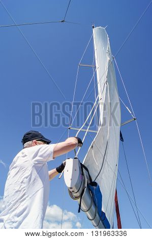 Tivat, Montenegro - 26 April, Man working with a sail, 26 April, 2016. Regatta