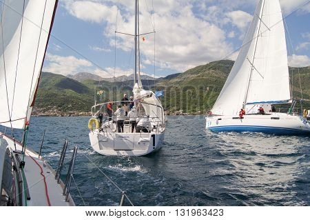 Tivat, Montenegro - 26 April, People on a sailboat with lowered sail, 26 April, 2016. Regatta