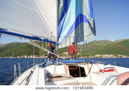 Tivat, Montenegro - 26 April, People on the bow of a sailing boat, 26 April, 2016. Regatta