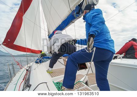 Tivat, Montenegro - 27 April, People on the boat pulling the rope, 27 April, 2016. Regatta