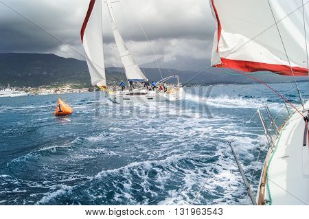 Tivat, Montenegro - 28 April, The boat with the team takes place near the buoy, 28 April, 2016. Regatta