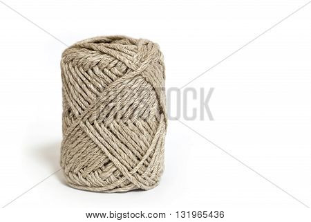 Ball of brown yarn on white background