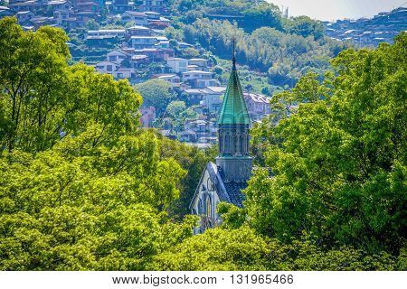 View of Oura Church in Nagasaki, Japan from between the trees.