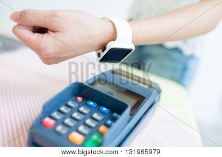 Customer paying through smart watch