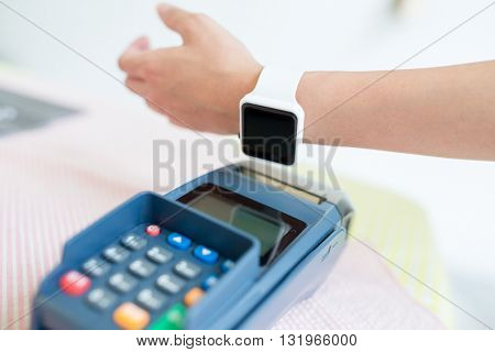 Online banking against woman using smart watch to express pay