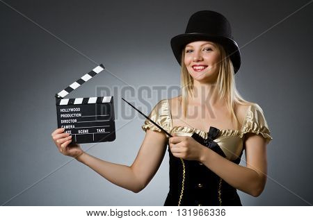 Funny woman in dark studio