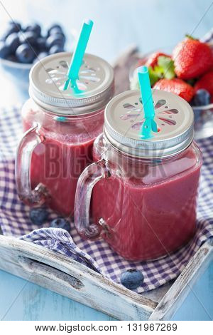 healthy strawberry blueberry smoothie in mason jars