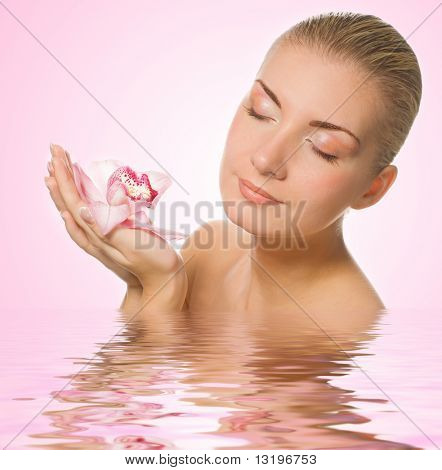 Blond girl with pink orchid reflected in rendered water