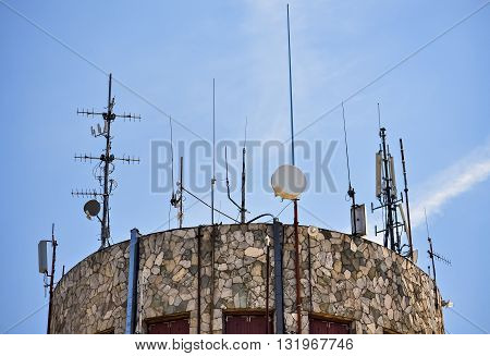 Closeup of antenna tower and clear blue sky in the background