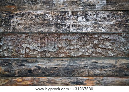 Horizontally arranged weathered wooden planks for background