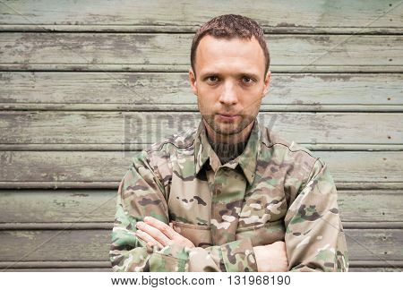 Young Handsome Caucasian Man In Camouflage