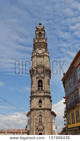 PORTO PORTUGAL - MAY 27 2016: Bell tower (Torre dos Clerigos circa 1763) of Clerigos Church in the historical center of Porto Portugal. World Heritage Site of UNESCO
