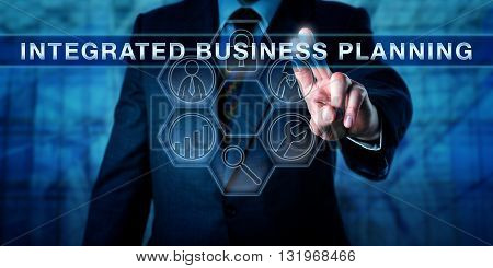 Executive pressing INTEGRATED BUSINESS PLANNING on an interactive virtual touch screen interface. Business performance function metaphor and corporate concept for strategic planning and management.