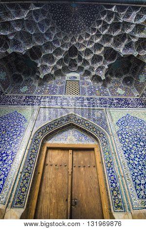 door and beautiful blue pattern in sheikh lotfollah mosque in esfahan, iran