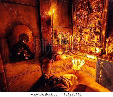 Jerusalem, Israel - February 17, 2013: Pilgrims  Praying Inside Aedicule In Church Of Holy Sepulchre
