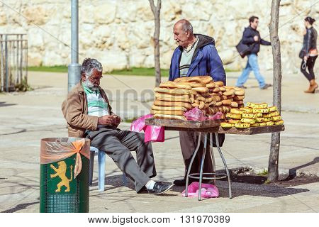 Jerusalem, Israel - February 20, 2013: Bread Street Vendor Chatting With Friend