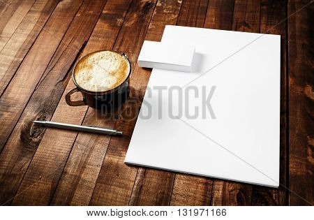 Mock-up for ID. Blank paperwork stationery set. ID template on vintage wooden table background. Blank letterhead business cards coffee cup and pen.