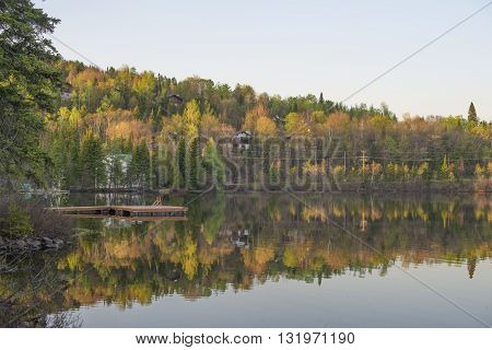 Lake reflection with fall color. Laurentides, Quebec Canada