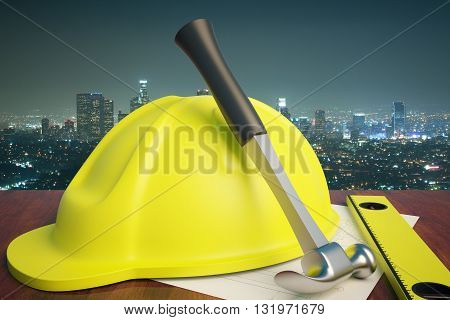 Wooden desktop with yellow helmet and tools on night city background. 3D Rendering