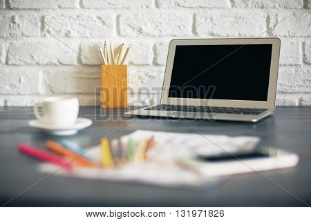 Laptop And Blurry Items