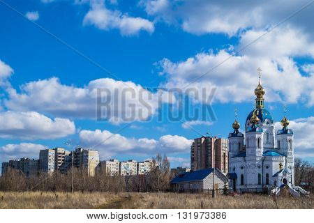 Alexander Nevsky church on a clear day and thick clouds