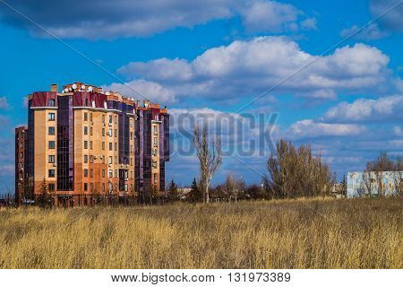 The new multi-storey building on a background of blue sky