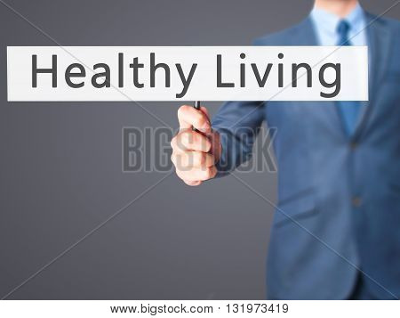 Healthy Living - Businessman Hand Holding Sign