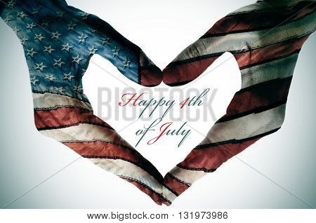 man hands patterned with the flag of the United States forming a heart and the sentence happy 4th of july
