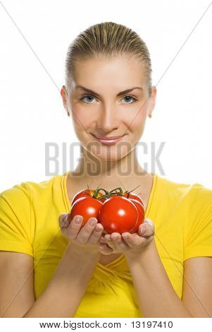 Beautiful young woman with ripe tomatoes