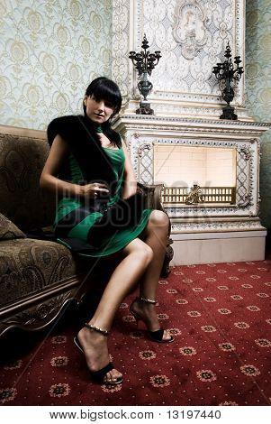 Beautiful brunette near the fireplace