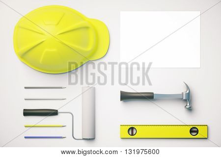 Top view of white desktop with yellow helmet tools and blank paper sheet. Mock up 3D Rendering