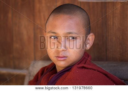 INLE LAKE MYANMAR - JANUARY 13 2016: Unidentified young monk in buddhist monastery
