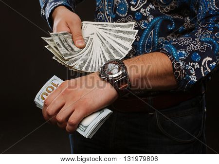 Time is money. The concept of time and money. A man holding a lot of money and shows up on time