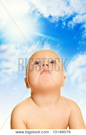 Beautiful baby over blue cloudy sky