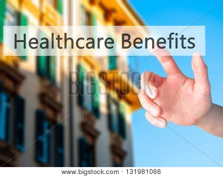 Healthcare Benefits - Hand Pressing A Button On Blurred Background Concept On Visual Screen.