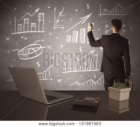 A young marketing office worker drawing pie chart and graph on wall at financial meeting concept