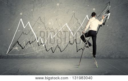 A male in elegant suit standing on a small ladder and drawing progressing lines on grey wall background