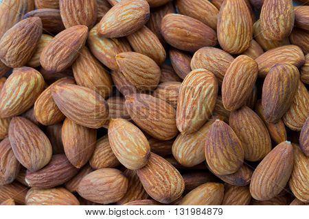 a lot of almonds close-up as background.