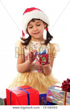 Smiling little girl with Christmas gift box